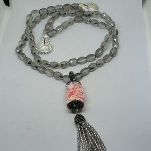 Pale gray faceted beads with detachable tassel